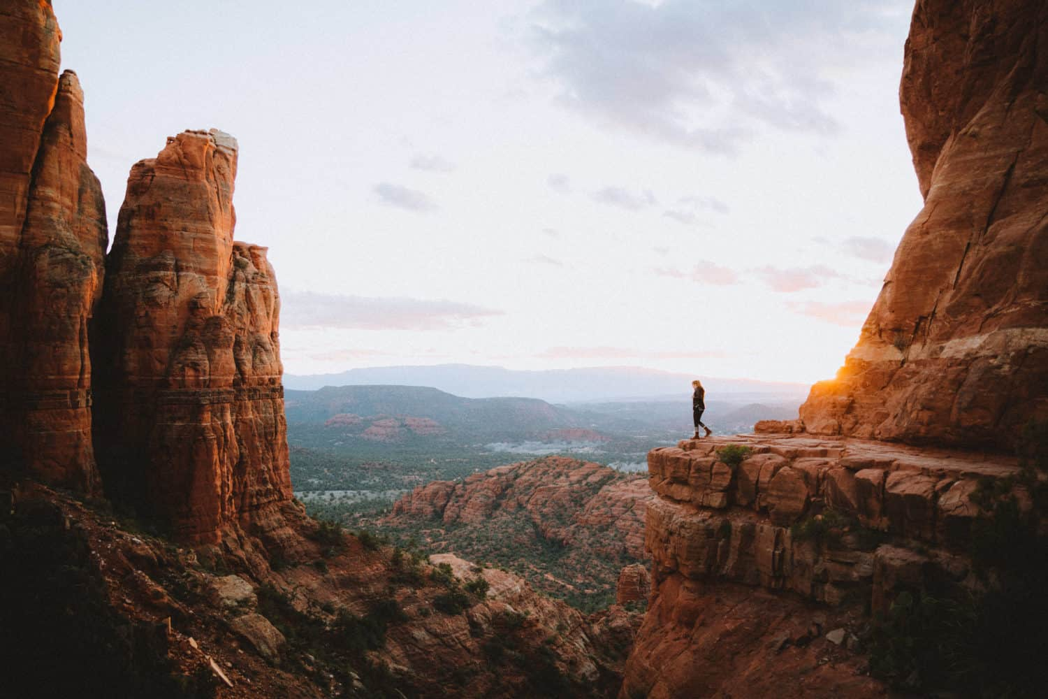 Emily Mandagie standing at Cathedral Rock during sunset - TheMandagies.com