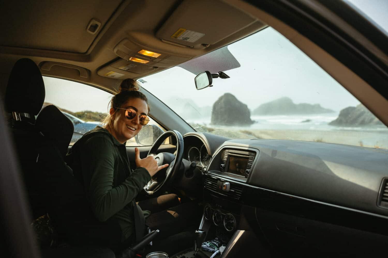 Emily Mandagie driving the Oregon Coast Highway 101