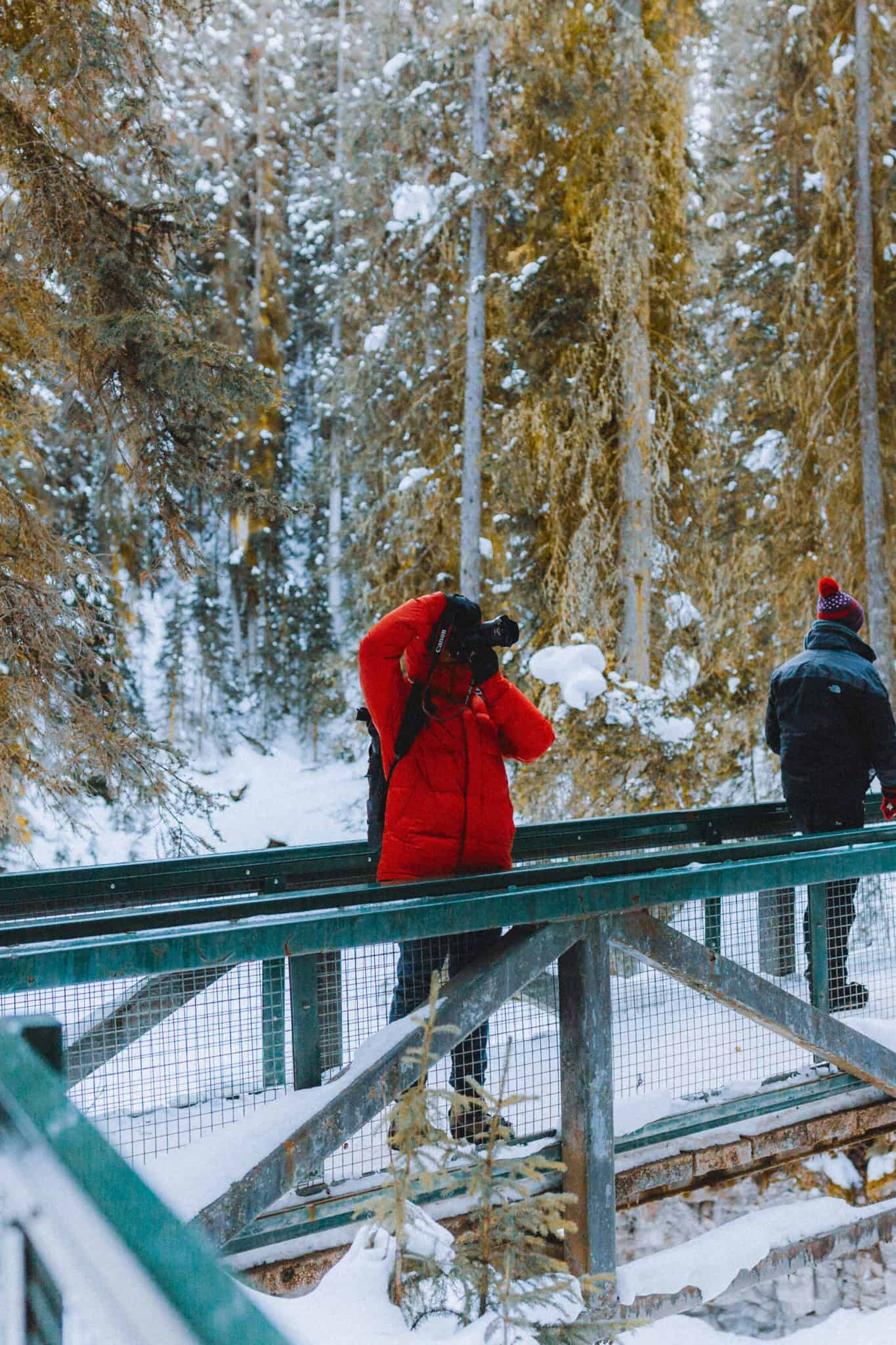 Berty Mandagie taking photos of Johnston Canyon in winter