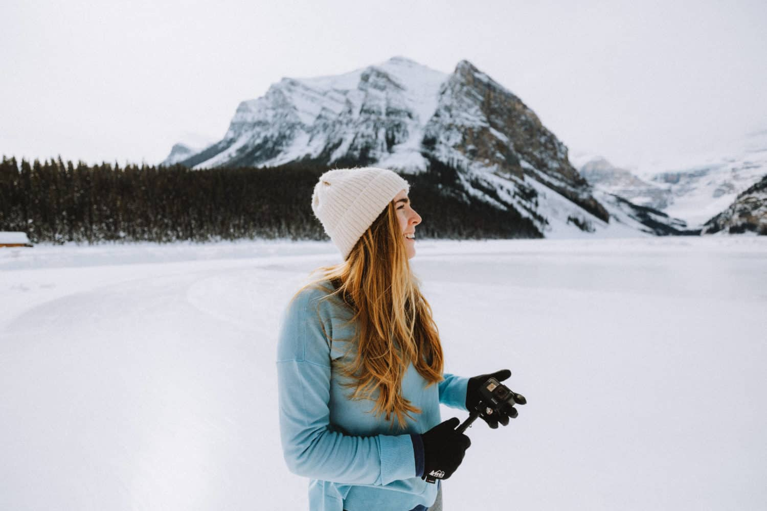 Emily wearing layers in Lake Louise - Banff winter packing list - TheMandagies.com