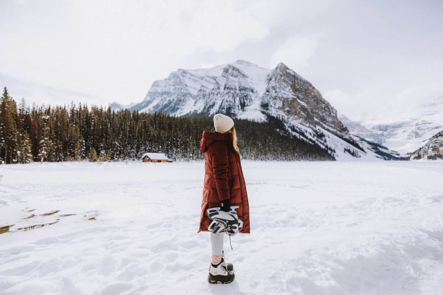 Emily wearing red parka - What to pack fro Banff in March - TheMandagies.com