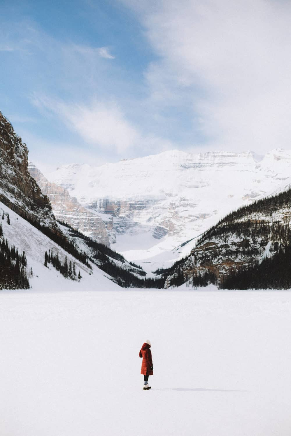 View of Frozen Lake Louise in Banff National Park - TheMandagies.com