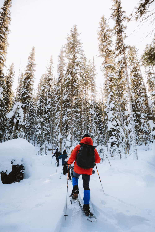 Berty Mandagie snowshoeing in Canada in the winter - TheMandagies.com