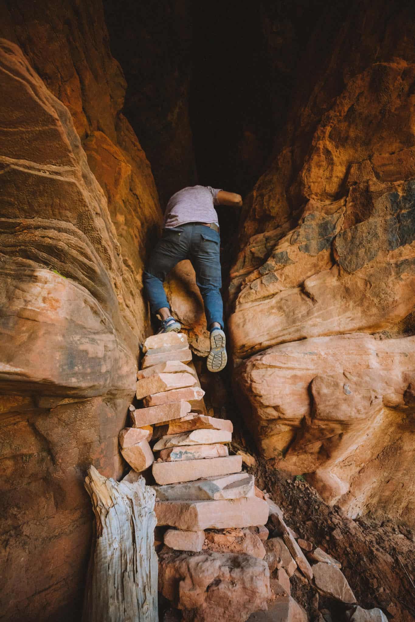 Berty Mandagie climbing into Soldiers Pass cave, Sedona