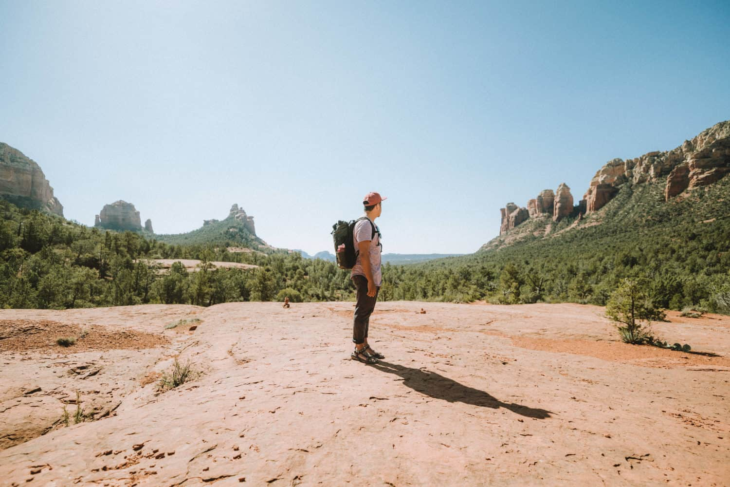 Berty Mandagie standing on Soldiers Pass Trail in Sedona, Arizona