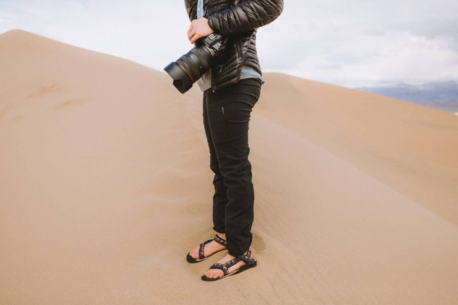 Emily Mandagie standing on Mesquite Flat Sand Dunes - One Day In Death Valley