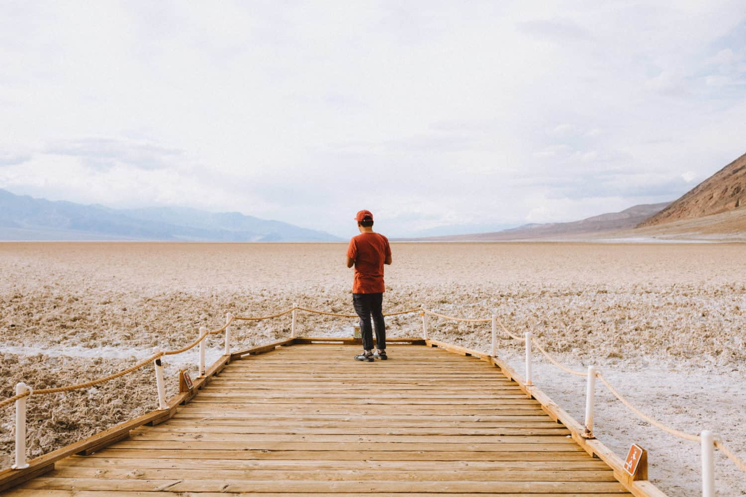 Berty Mandagie standing at Badwater basin - Death Valley In one Day - TheMandagies.com