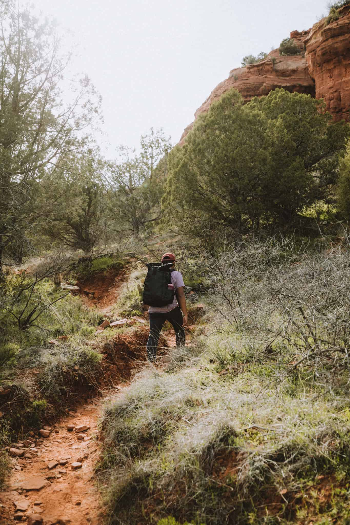 Berty taking the trail up to the birthing cave
