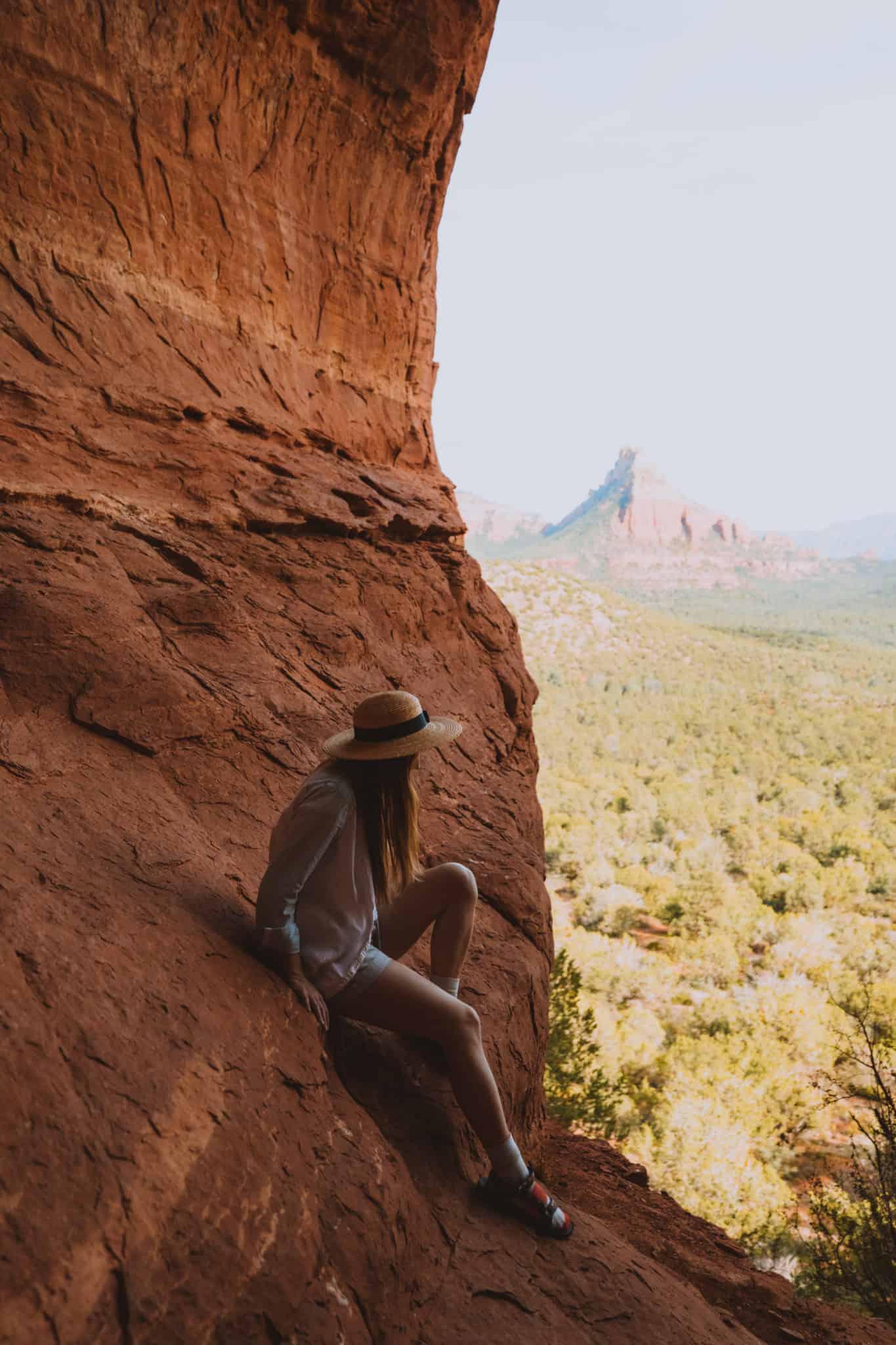 Emily Mandagie sitting in the birthing cave sedona