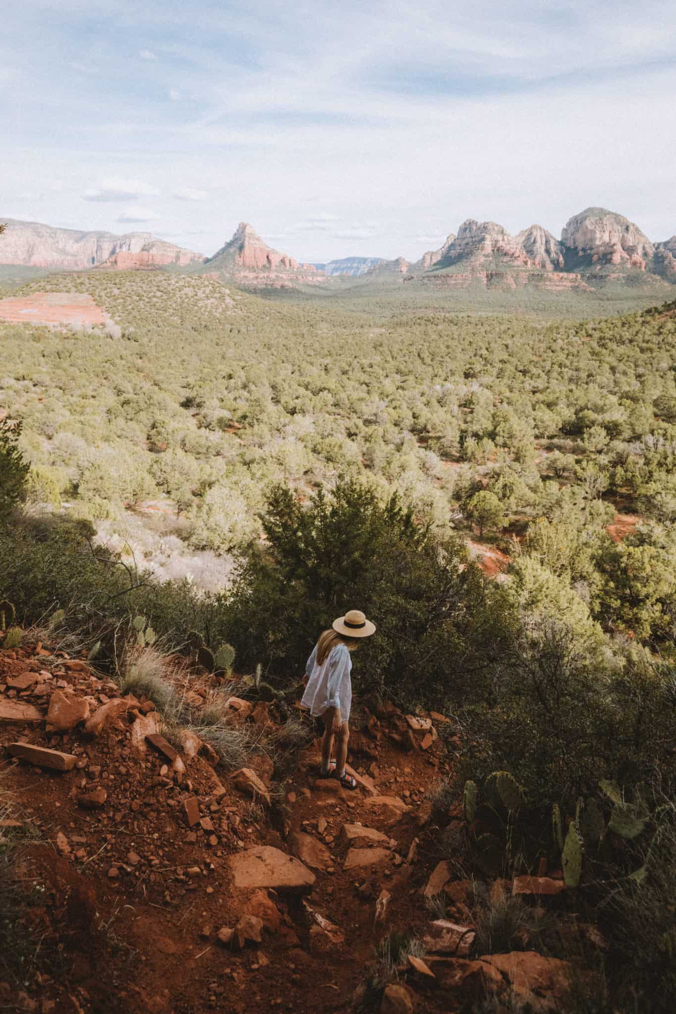 Emily Mandagie walking down trail at the Birthing Cave in Sedona