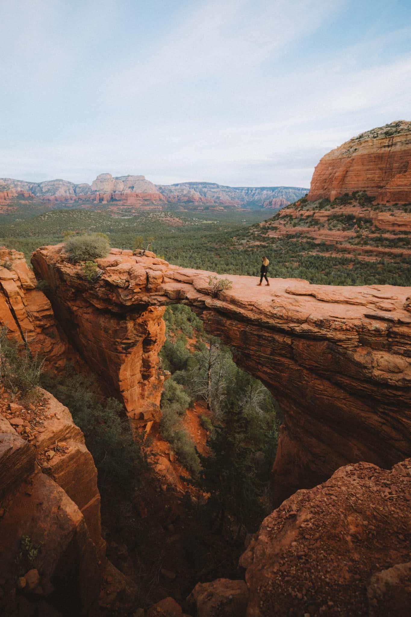 Emily walking on Devil's Bridge - Southwest Road Trip Destination -TheMandagies.com