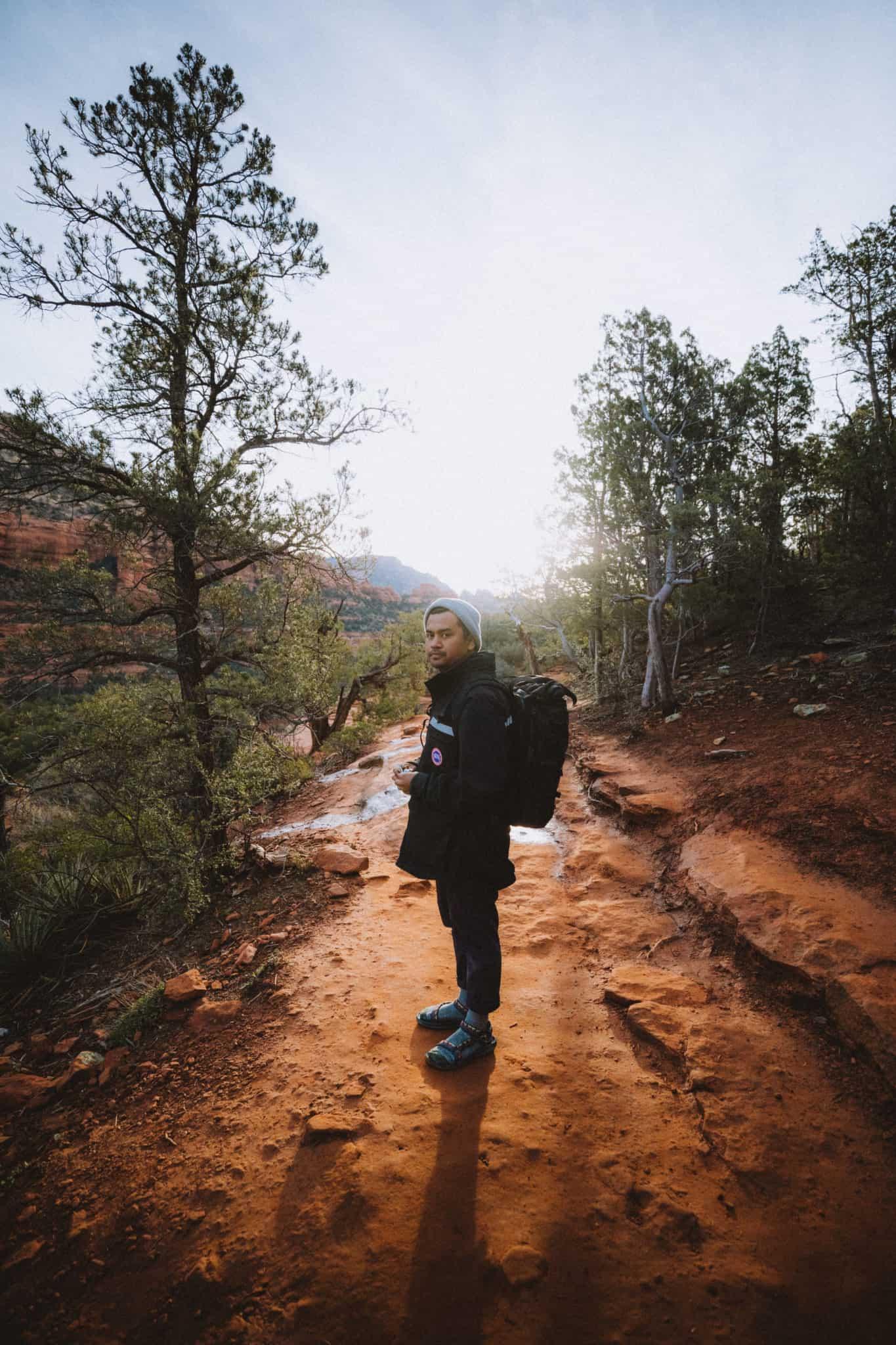 Berty standing on Devil's Bridge Trail during sunrise - TheMandagies.com