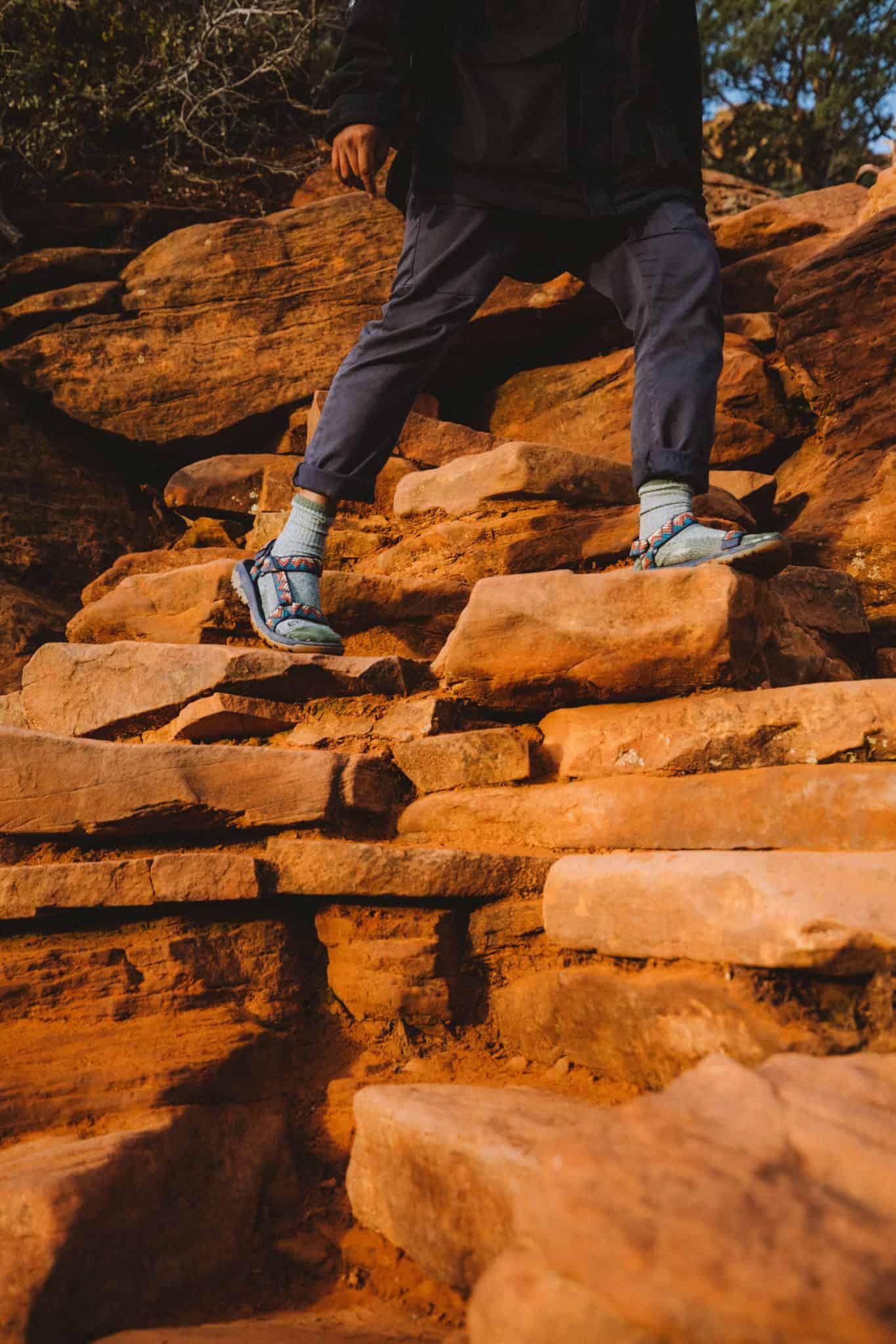 Berty Mandagie's shoes climbing rocks on Devil's Bridge Trail