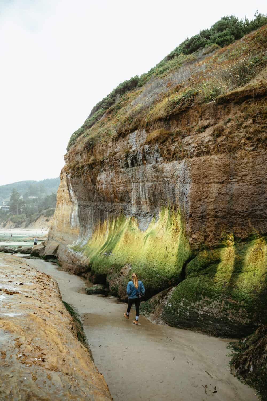 Emily Mandagie hiking at Devil's Punchbowl on the Oregon Coast