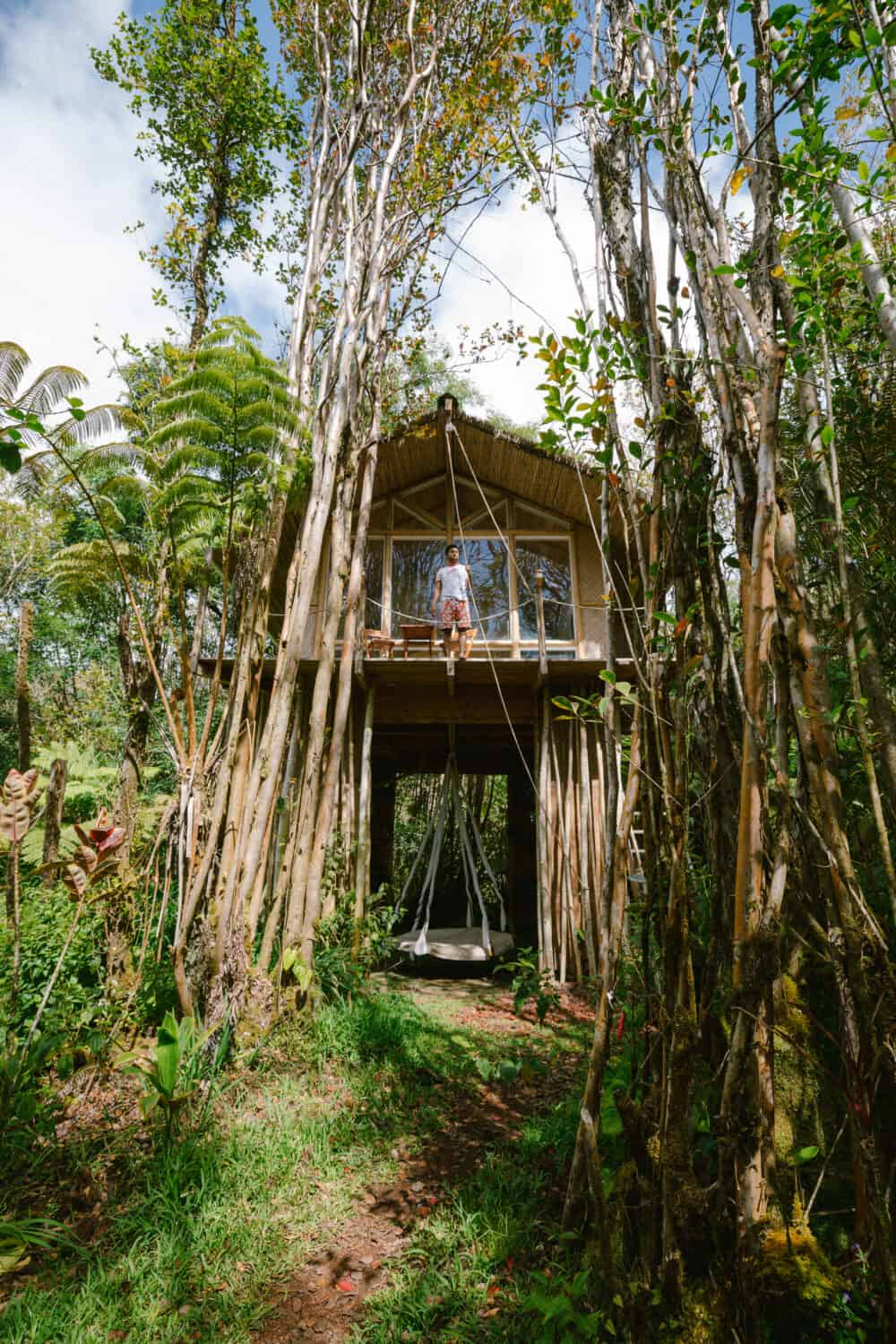 Berty Mandagie standing at treehouse in Hawaii - TheMandagies.com