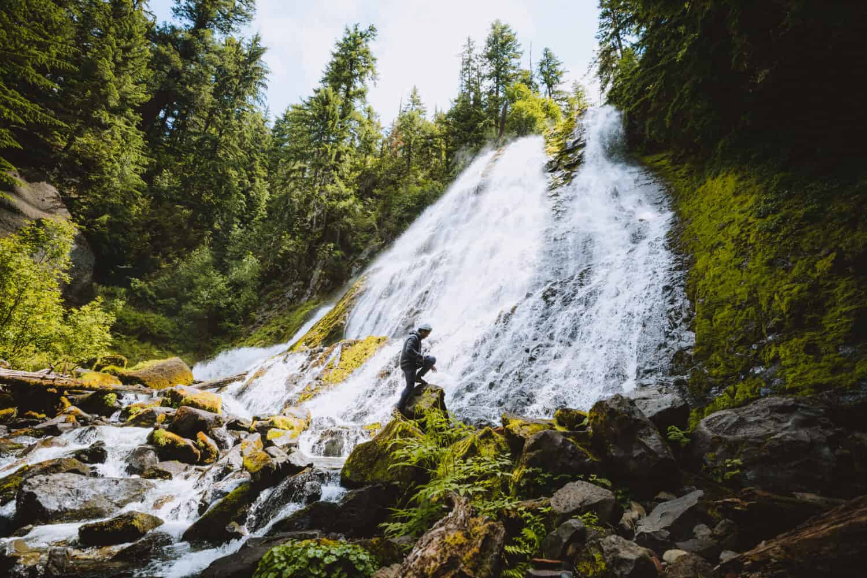 Berty standing at bottom of Diamond Creek Falls