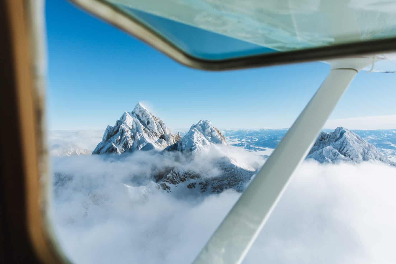 View of Grand Teton from plane window - TheMandagies.com