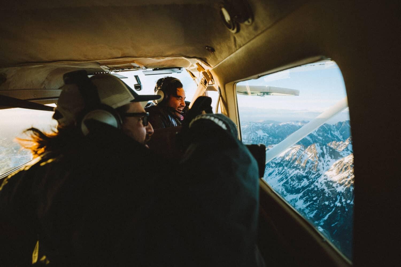 Photographers taking photos from plane window - TheMandagies.com