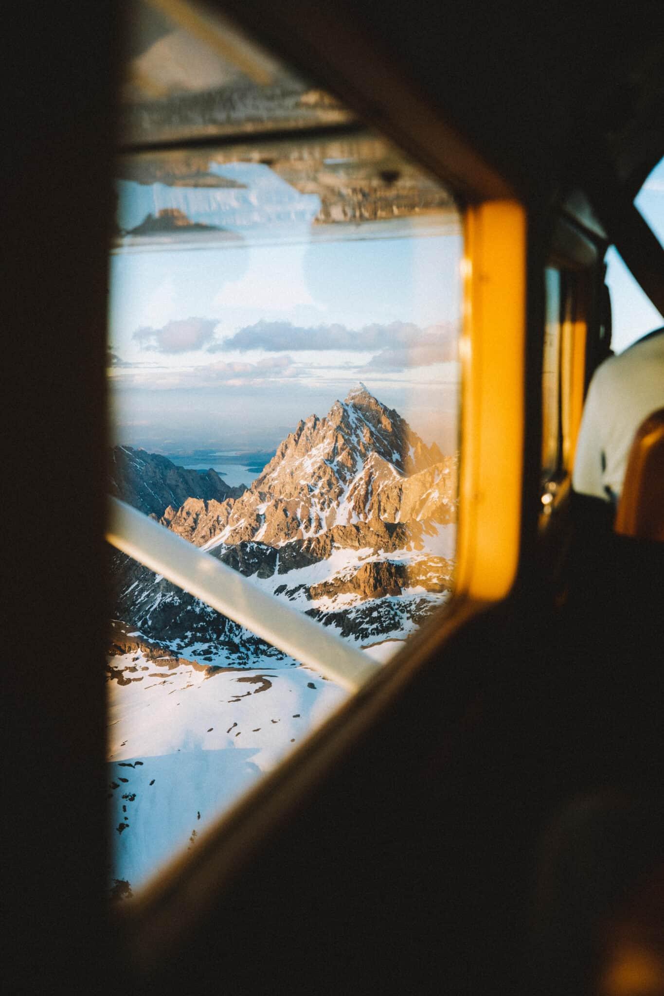 View of Grand Teton from plane window - TheMandagies.com