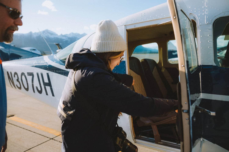 Emily entering plane - Fly Jackson Hole - TheMandagies.com