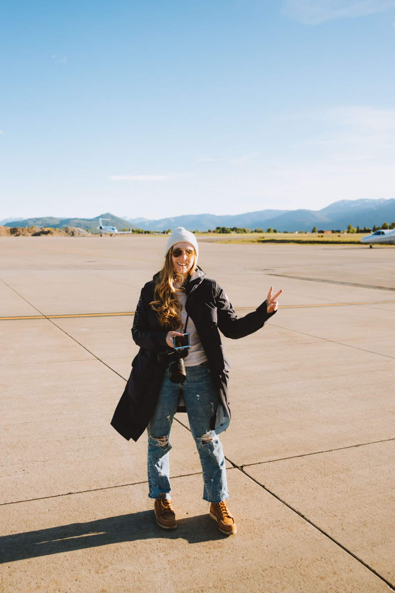 Emily standing on tarmac Fly Jackson Hole - TheMandagies.com