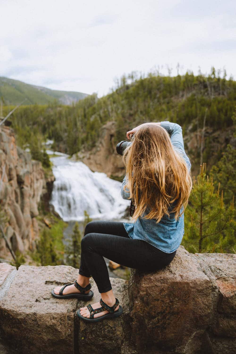 Emily talking a photo of Gibbon Falls in Yellowstone