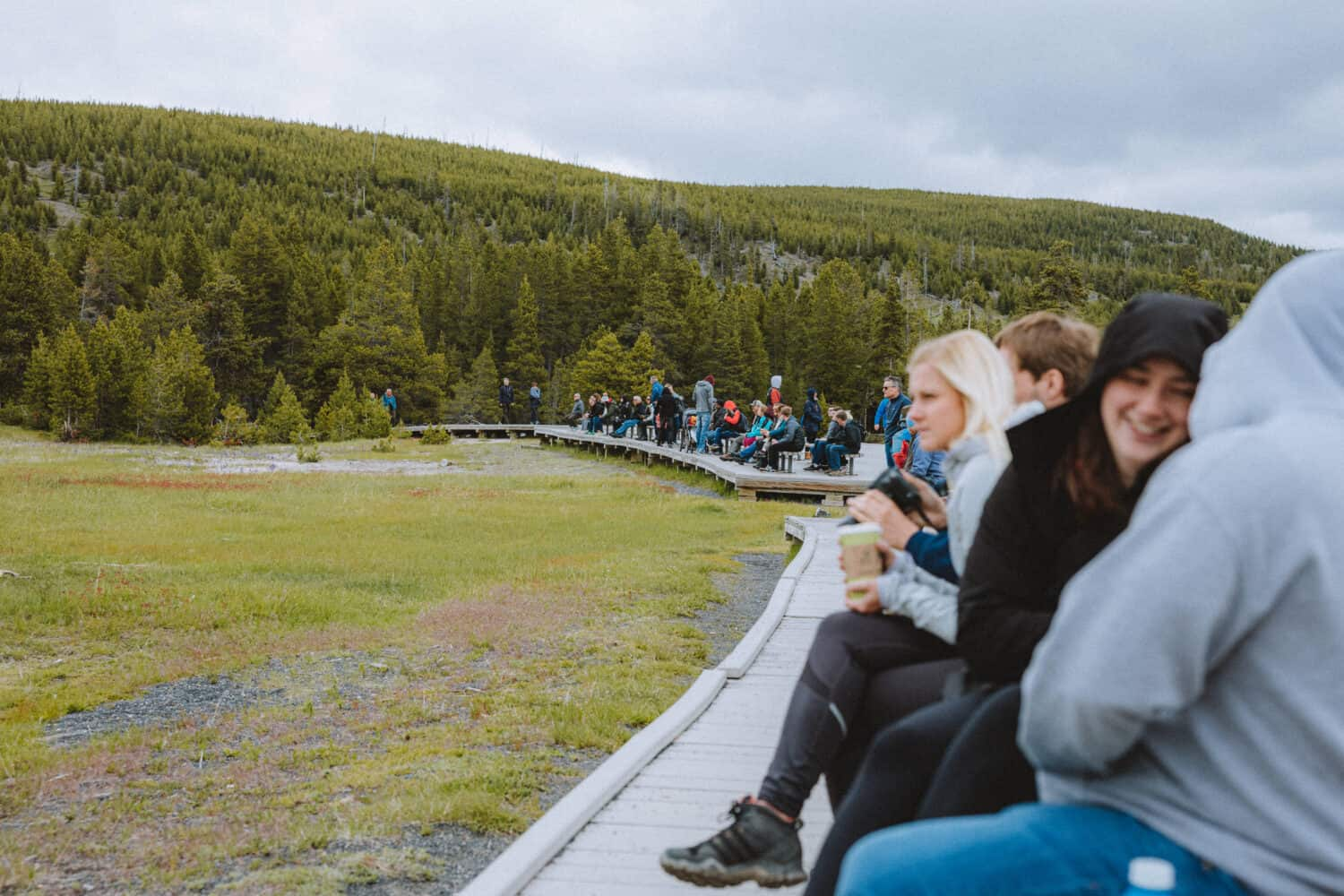 People waiting to watch Old Faithful erupt