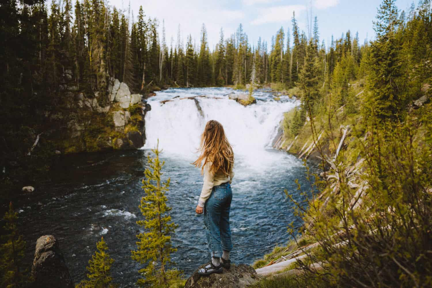 Emily standing at Lewis Falls, Yellowstone