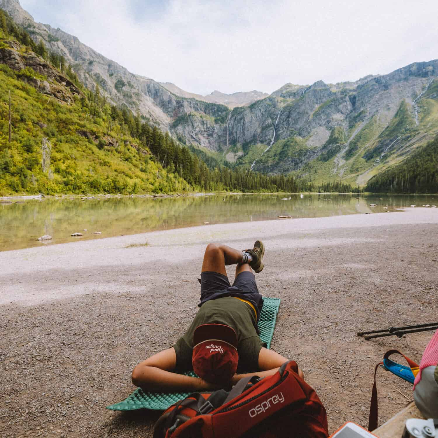 Berty Mandagie resting at Avalanche Hiking Trail in Glacier - TheMandagies.com