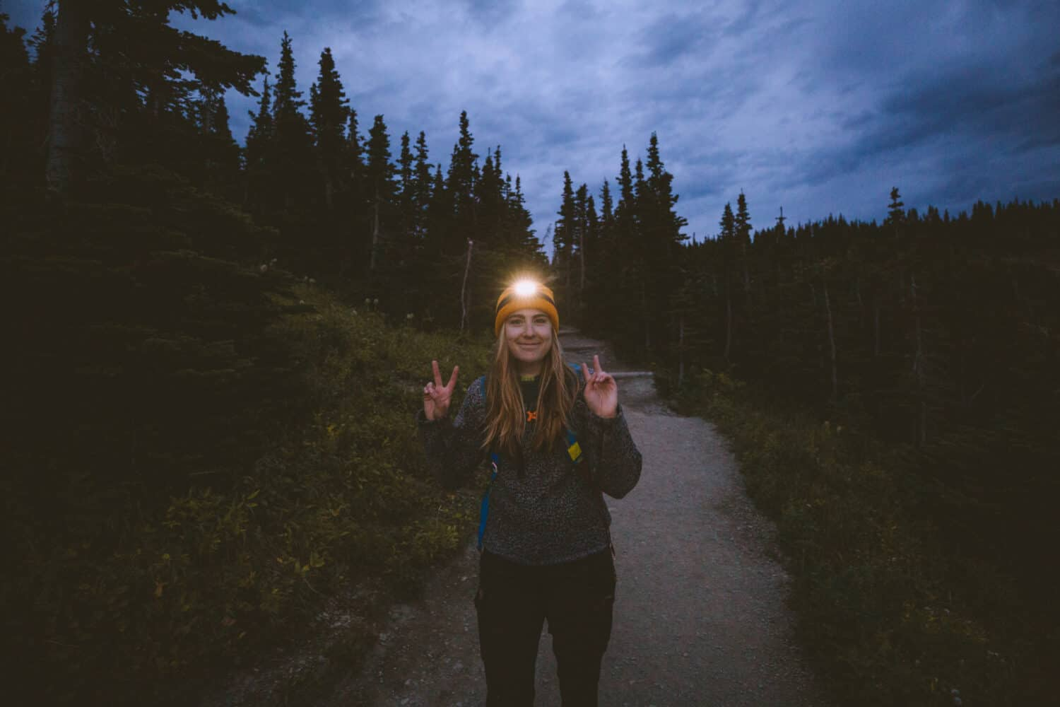Emily Mandagie wearing headlamp during hike in Glacier National Park - TheMandagies.com