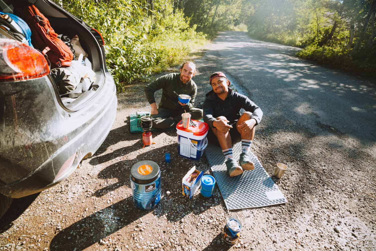 Joseph and Berty eating simple camping meals in Glacier NP