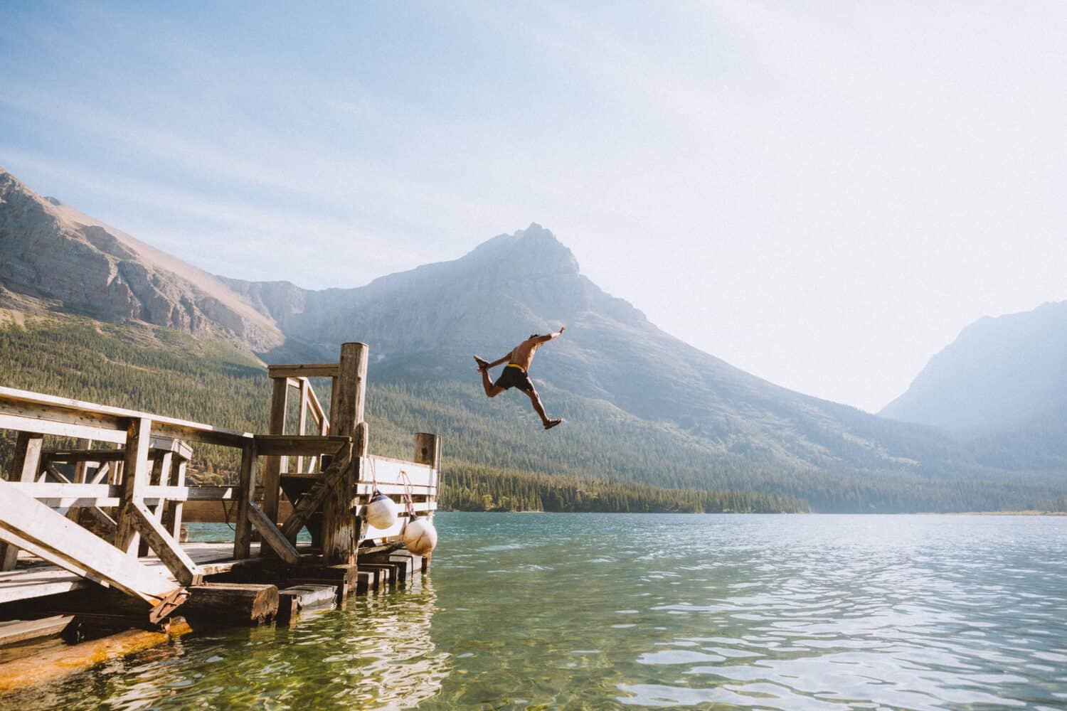 Berty Mandagie jumping into St Mary Lake, Glacier National Park