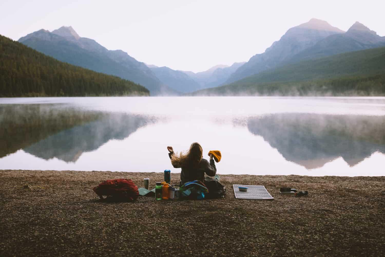 Emily watching reflection of Bowman Lake Montana