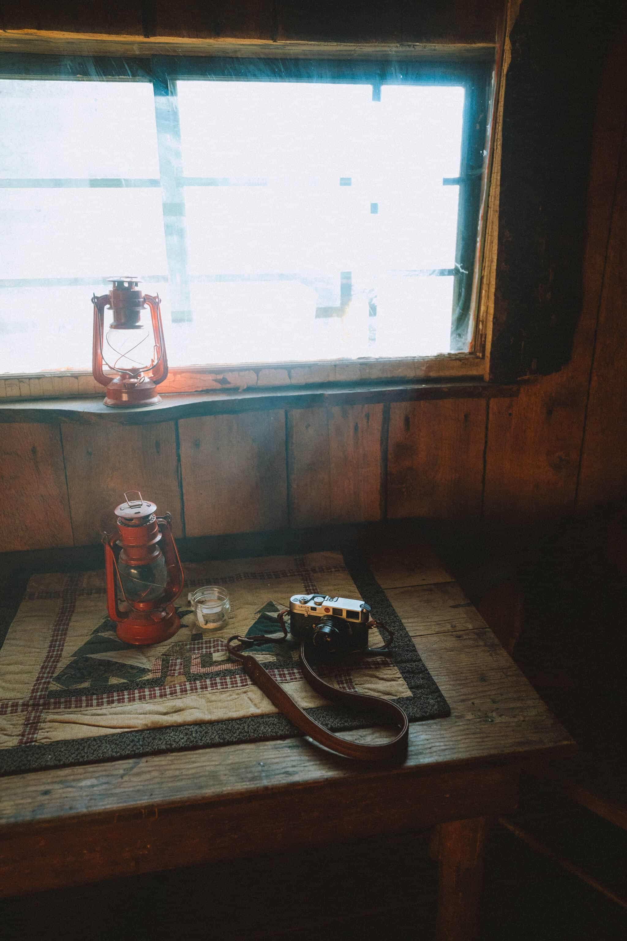Smokey window with camera and lantern on table