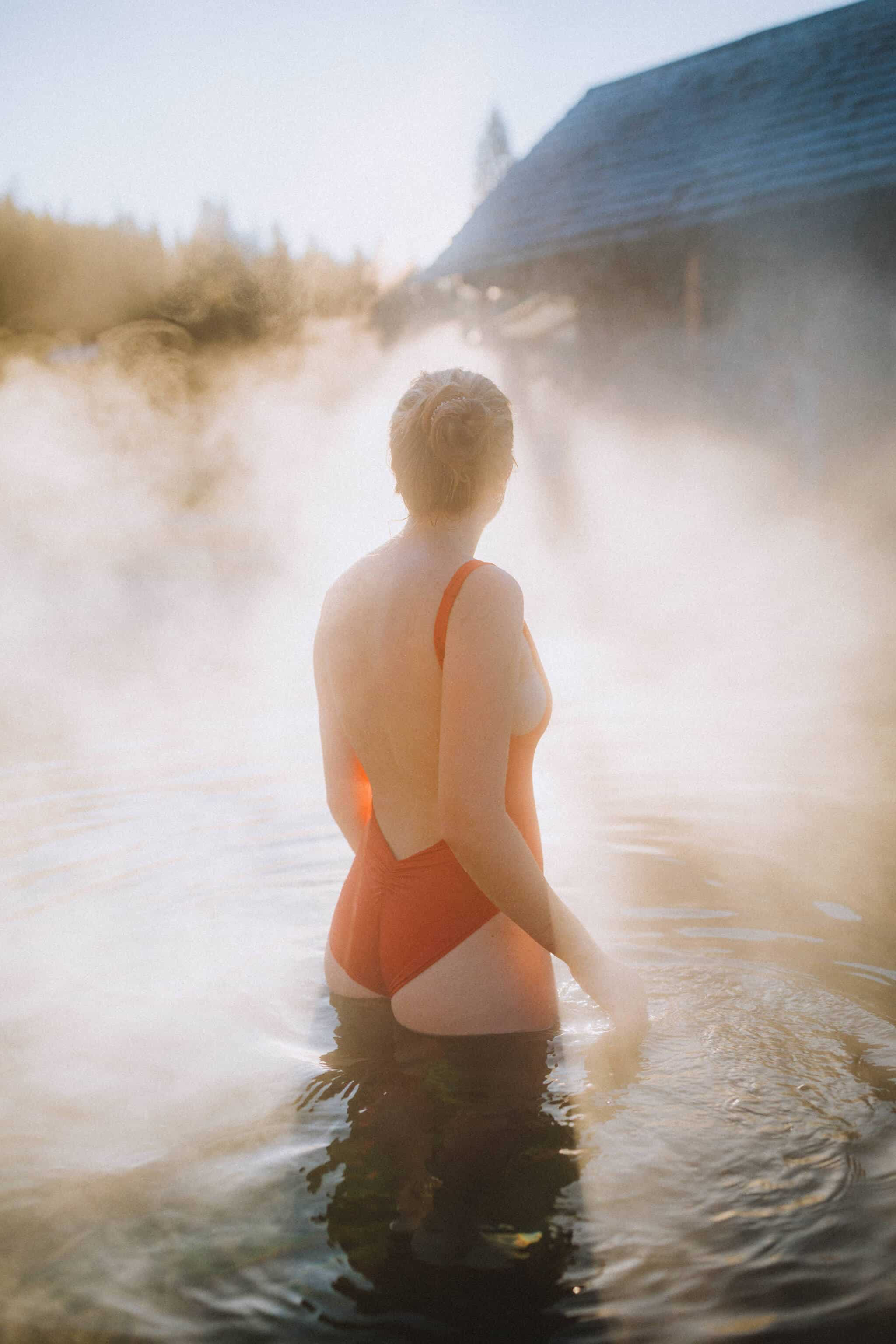 Emily Mandagie visiting Burgdorf pools at sunrise - TheMandagies.com