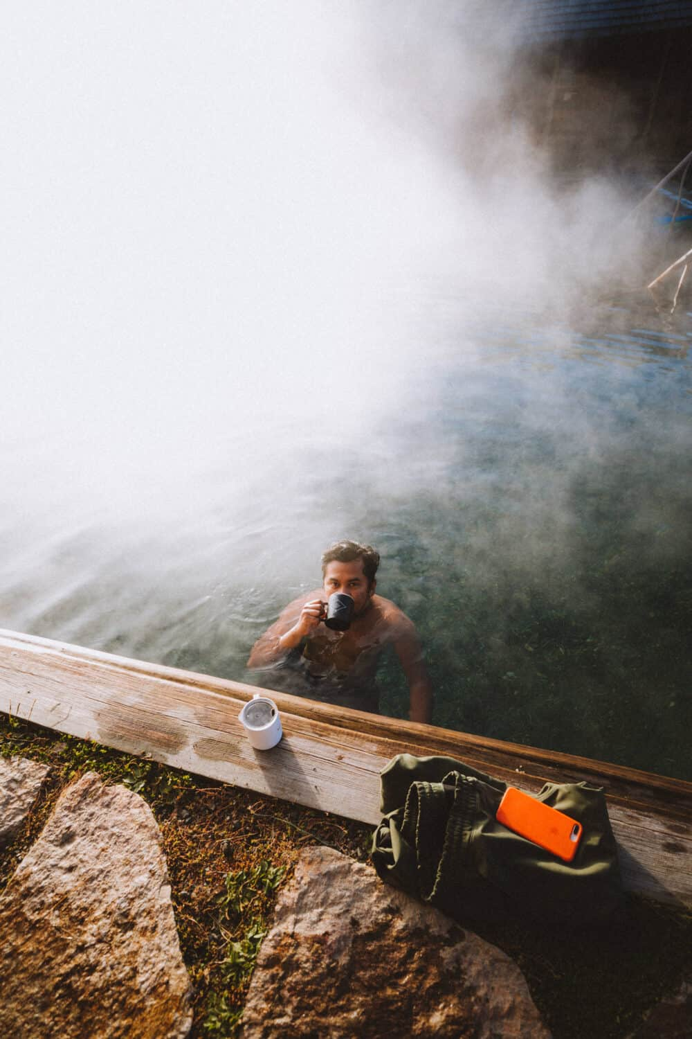 Berty Mandagie sipping coffee poolside at Burgdorf Hot Springs - TheMandagies.com