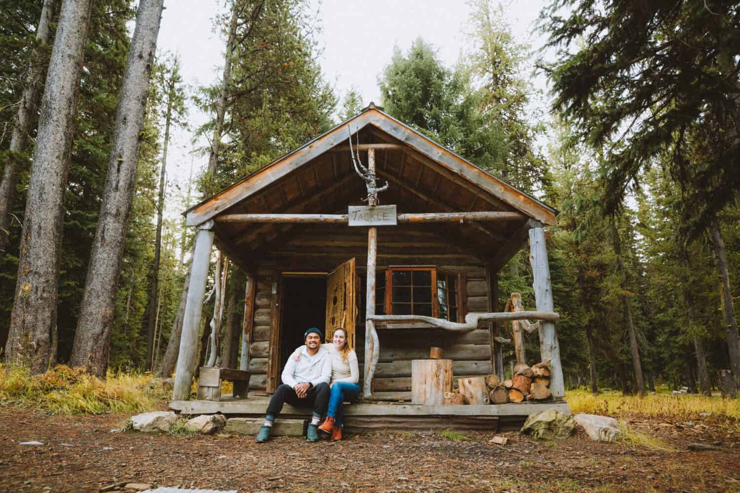 Berty and Emily Mandagie sitting outside cabin at Burgdorf Hot Springs, McCall Idaho - TheMandagies.com
