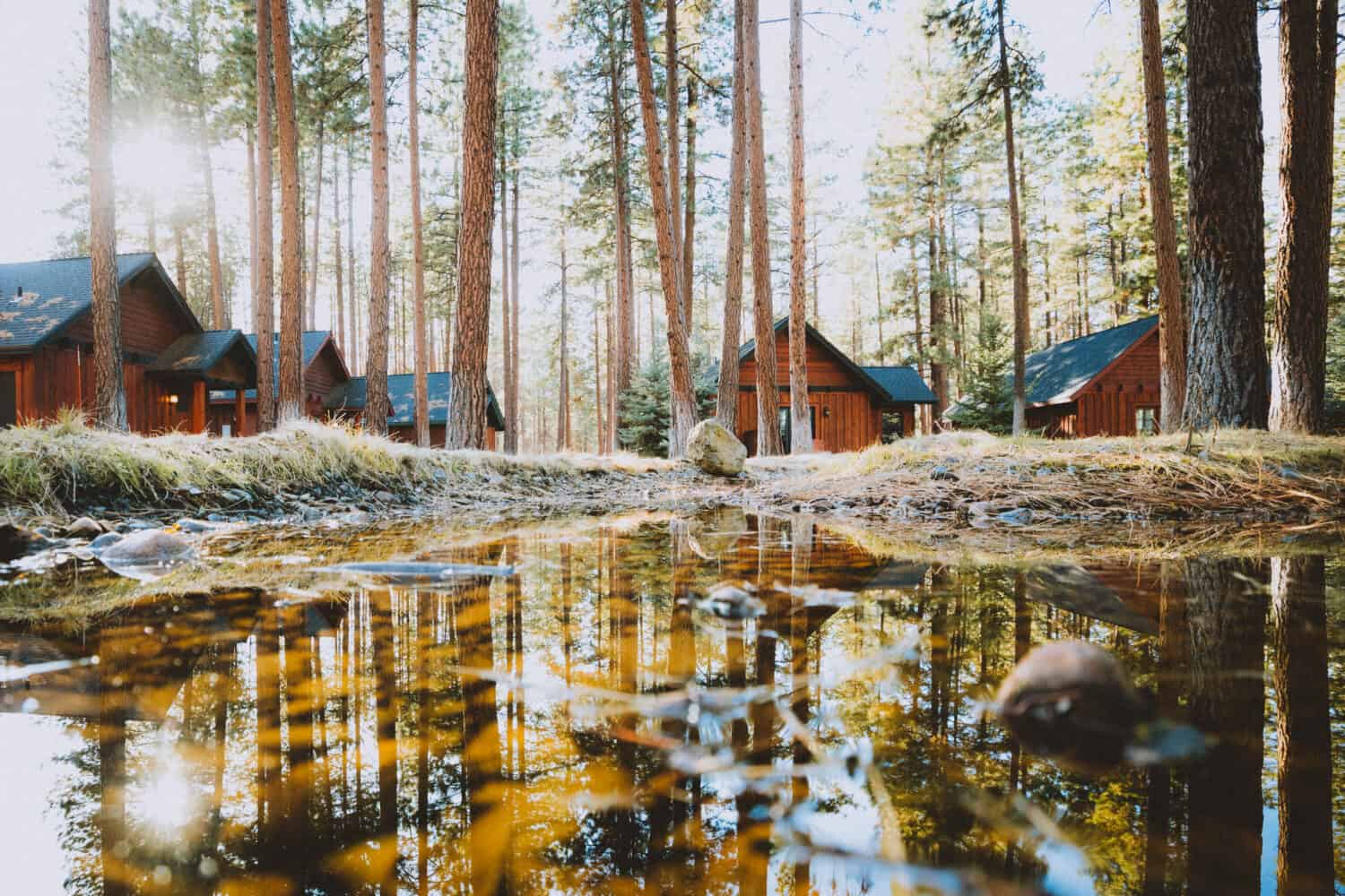 Reflection on water at FivePine Lodge Sisters, Oregon - TheMandagies.com