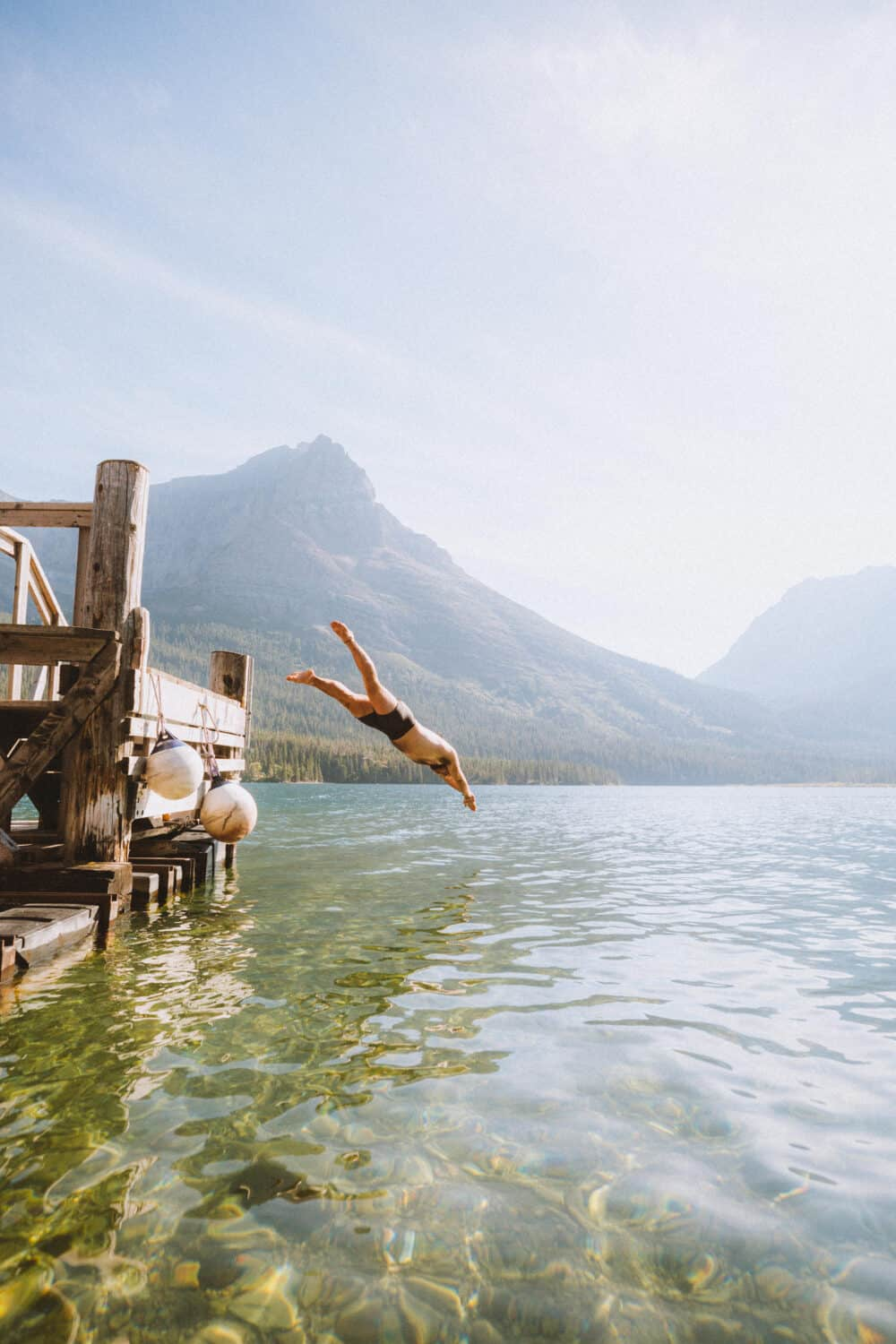 Summer in the Pacific Northwest - jumping in lakes of Glacier National Park