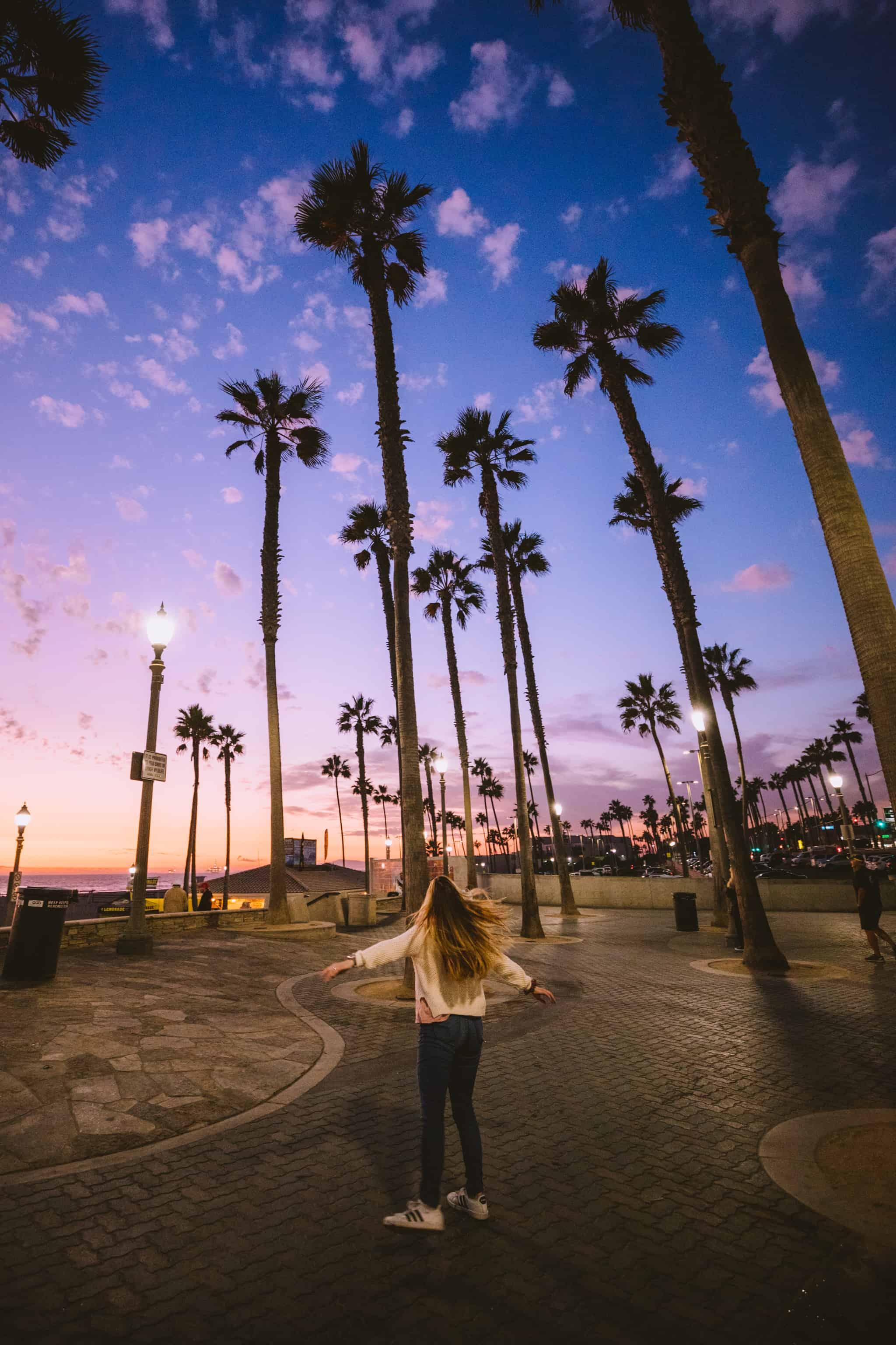Watching Sunset at Huntington Beach - TheMandagies.com