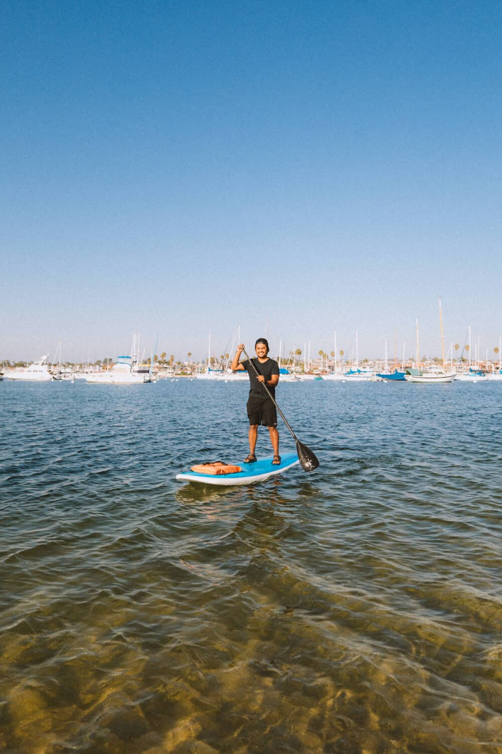 Paddle Boarding at Newport Beach Pier - TheMandagies.com