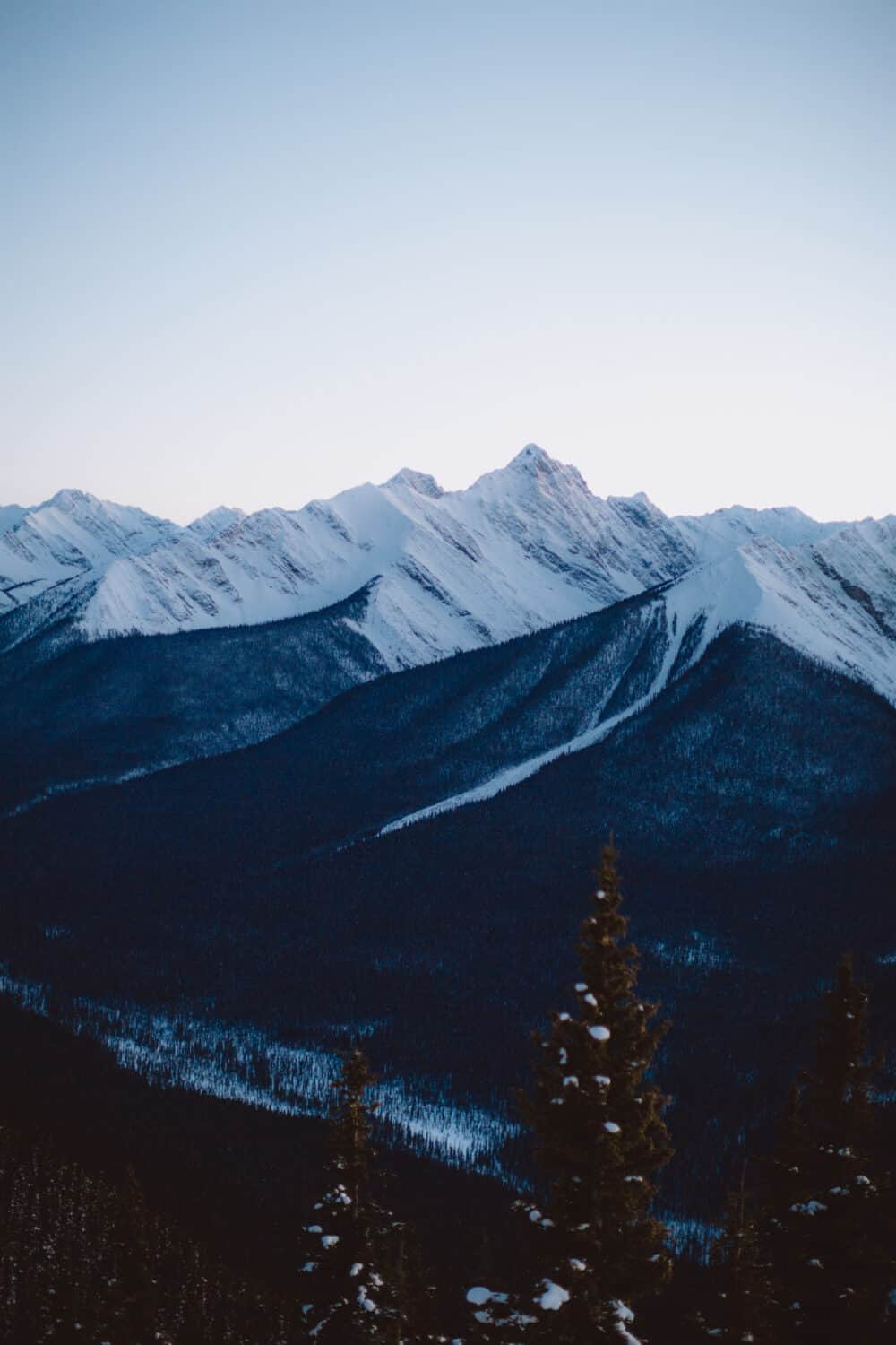 View of surrounding mountain ranges in Canadian Rocky Mountains - TheMandagies.com
