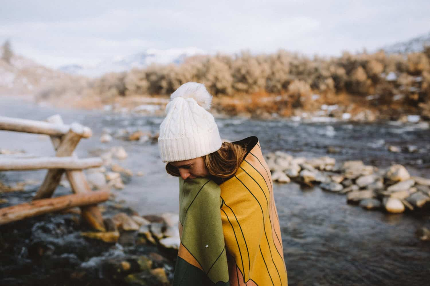 Emily Mandagie wrapped in towel at the Boiling River Yellowstone National Park - TheMandagies.com