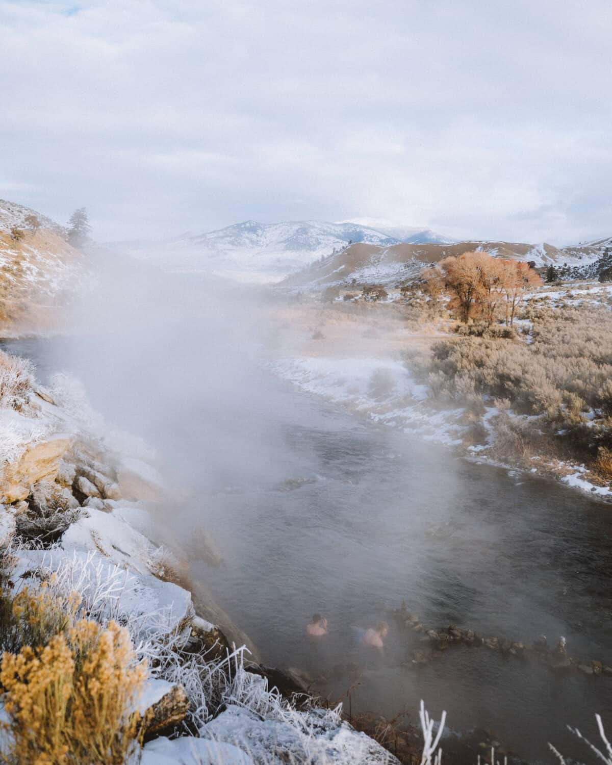 View of people soaking in the Boiling River - TheMandagies.com