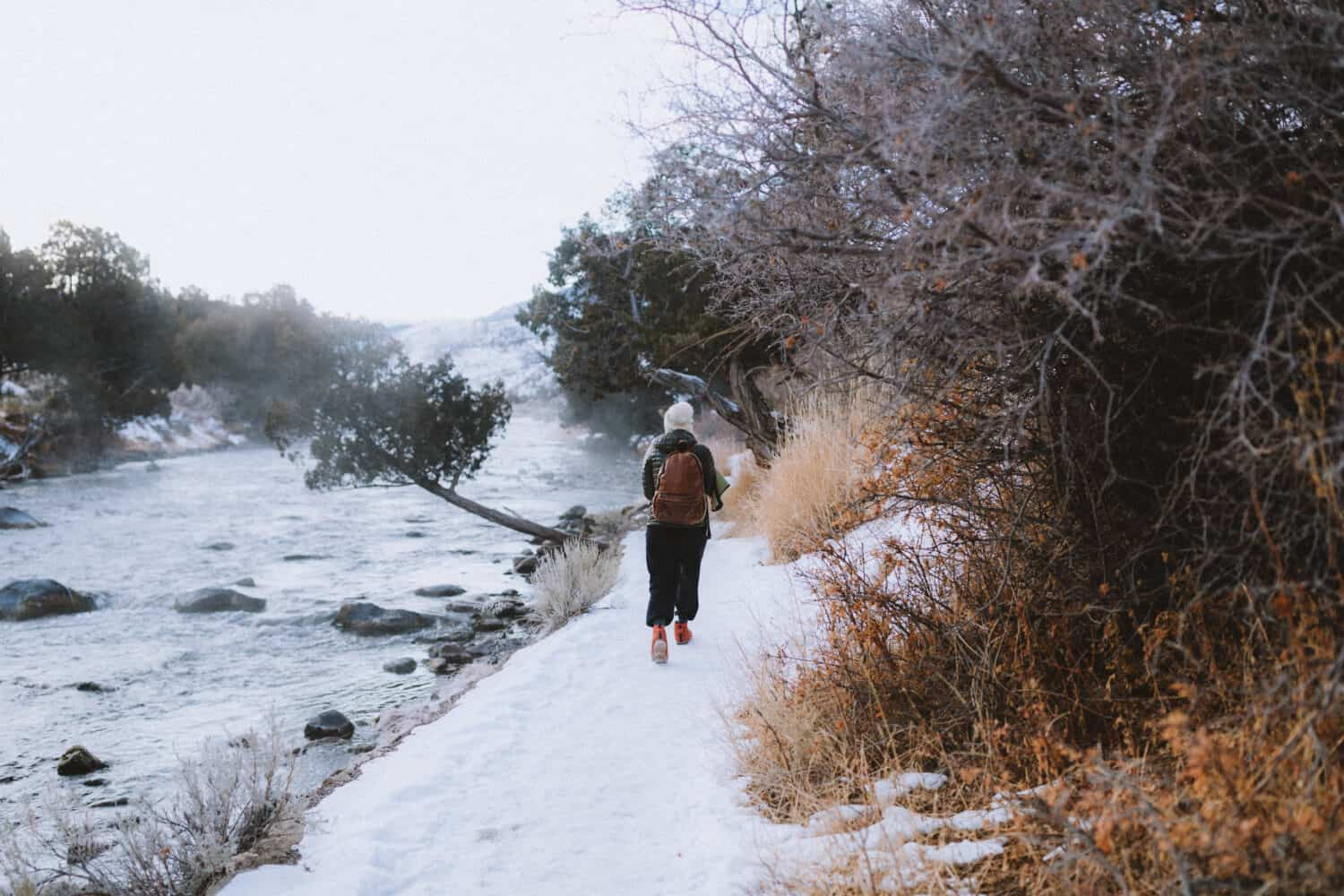 Emily walking on ice covered path - TheMandagies.com