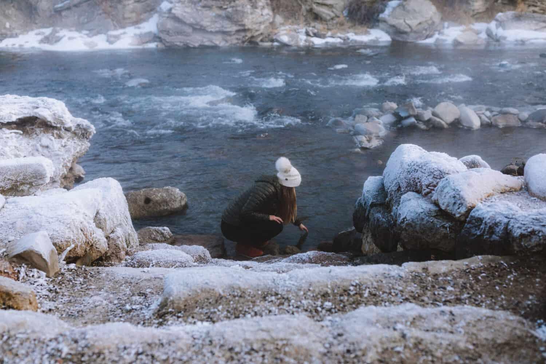 Emily Mandagie testing the water temperature - TheMandagies.com