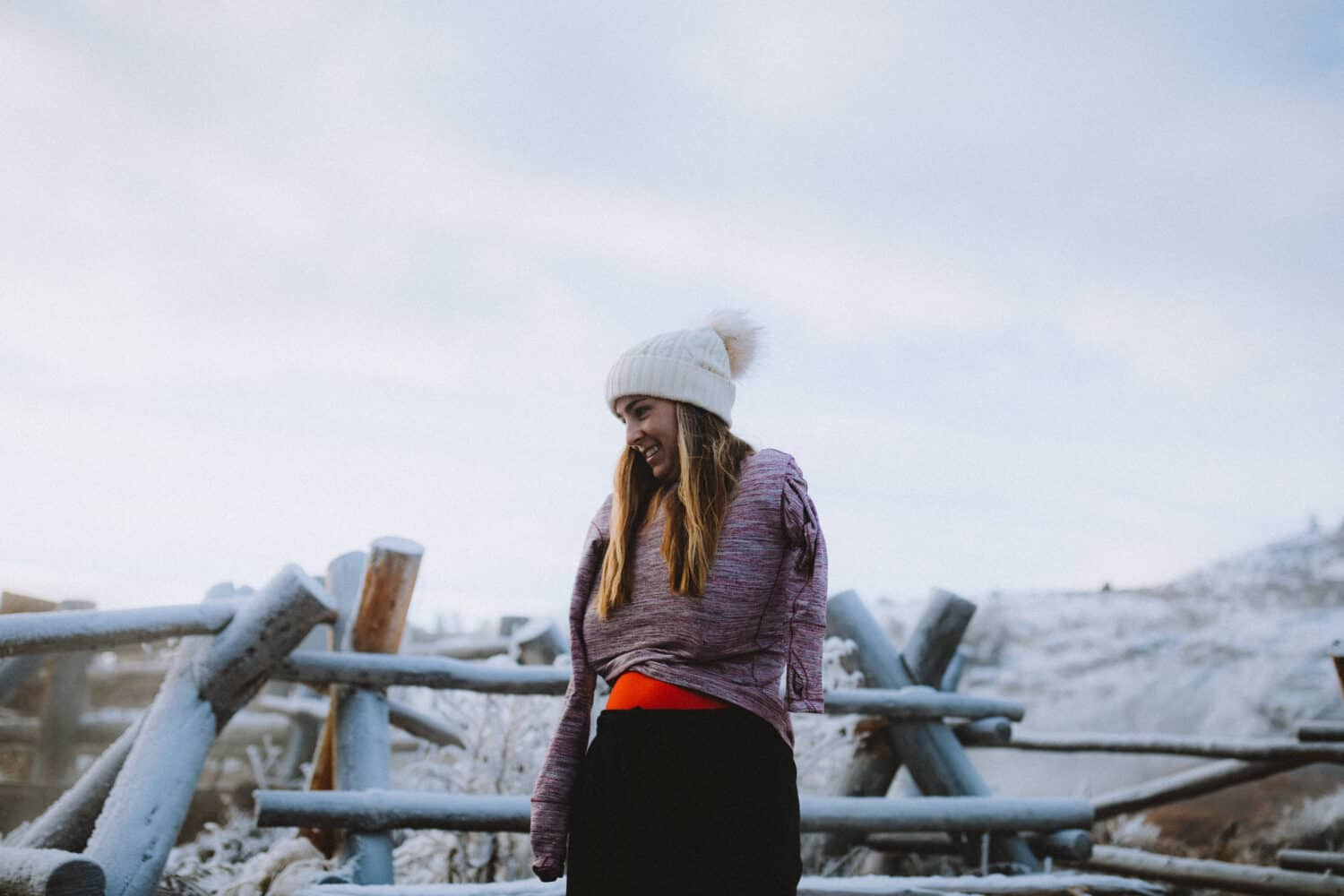 Emily Mandagie at Boiling River in Winter Yellowstone - TheMandagies.com