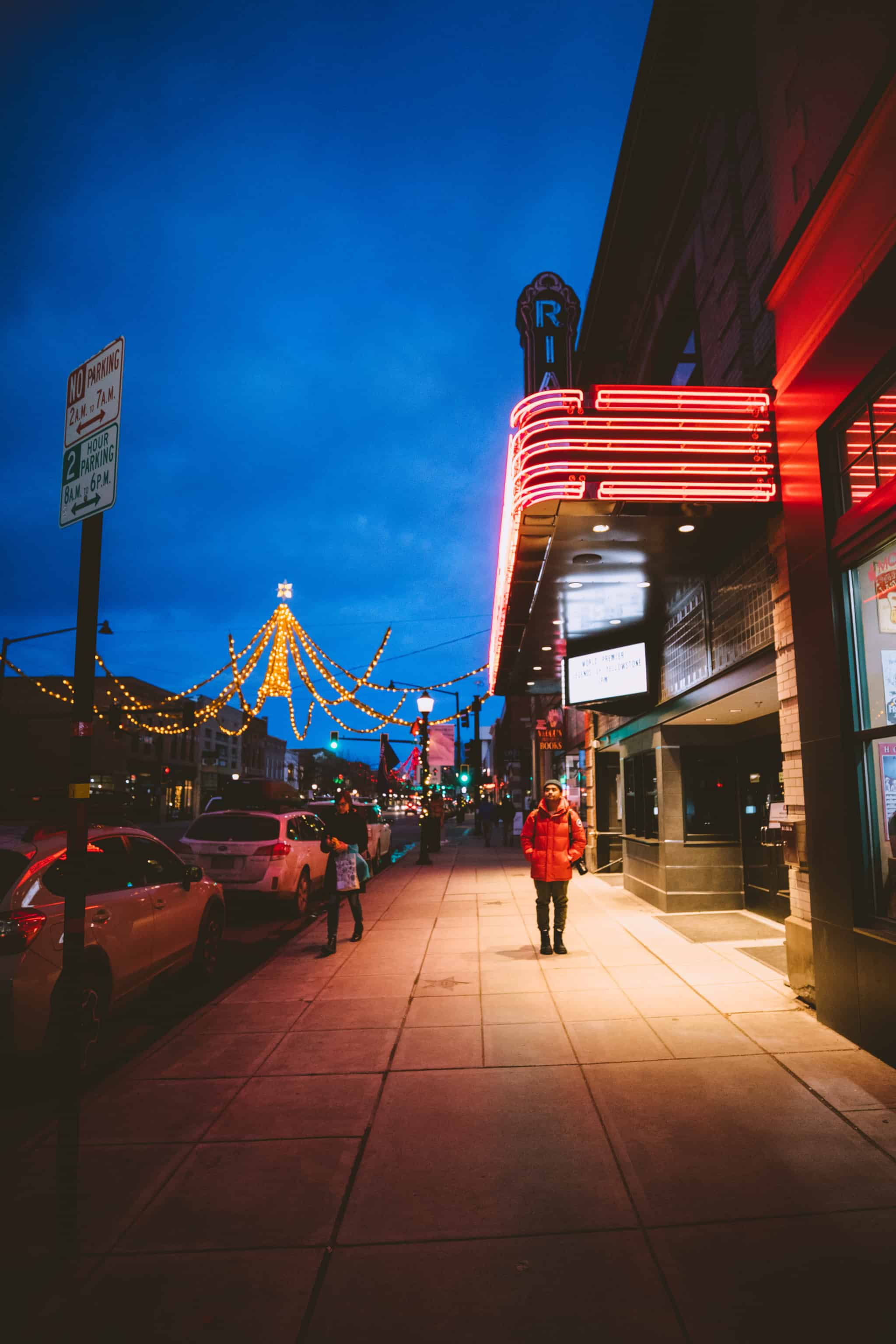 Berty Mandagie standing under Rialto Bozeman lights - TheMandagies.com