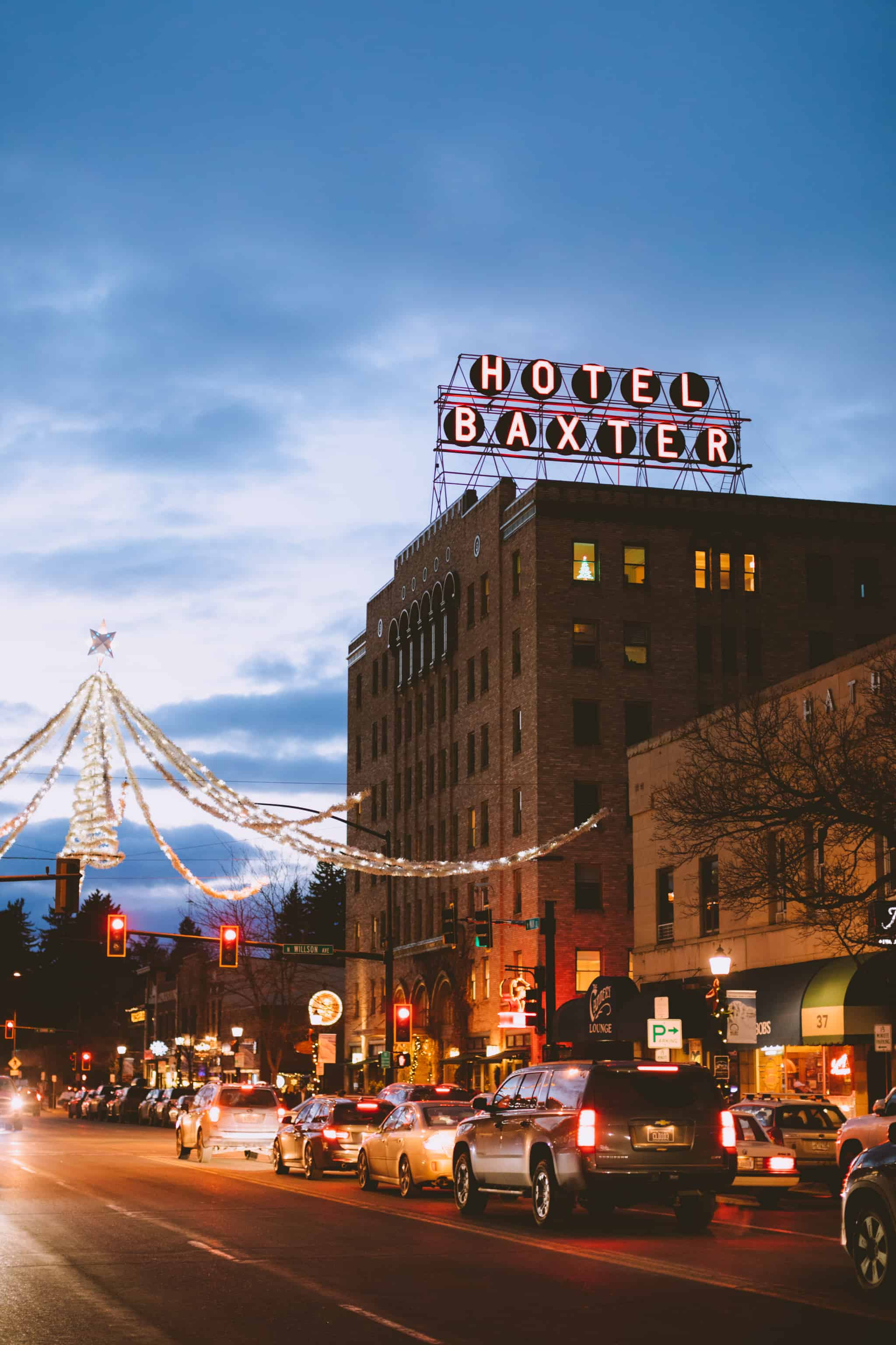 View of Hotel Baxter Downtown Bozeman in Evening with holiday lights - TheMandagies.com