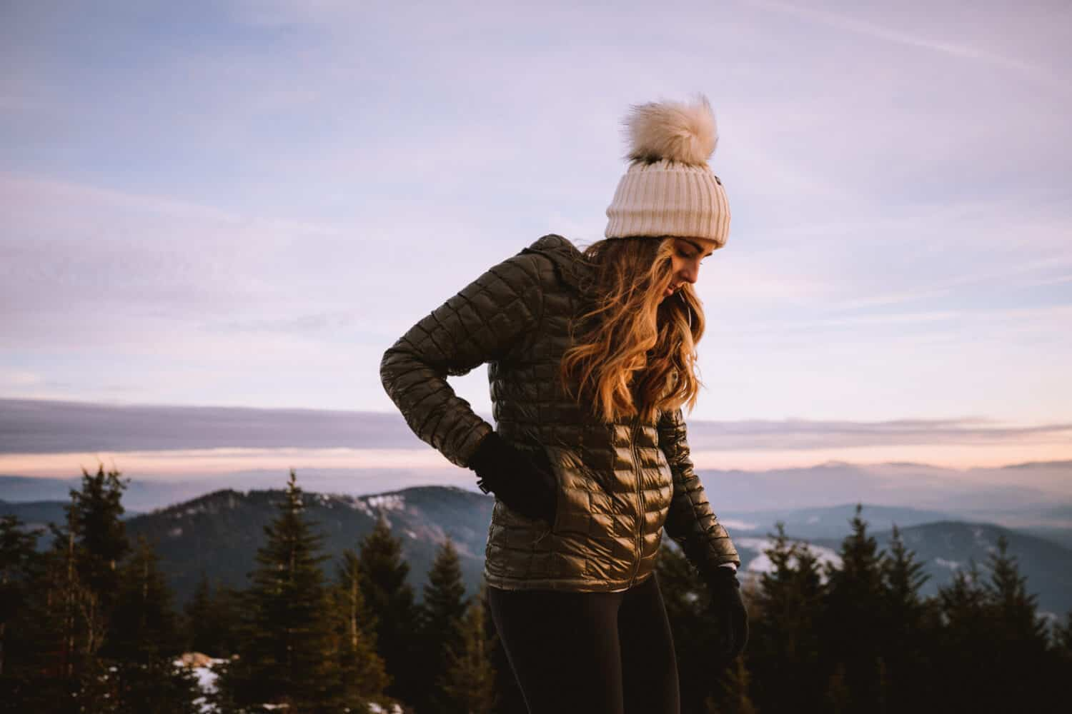 Emily wearing lightweight Nano Puff Jacket - Banff Winter Packing List Essentials - TheMandagies.com